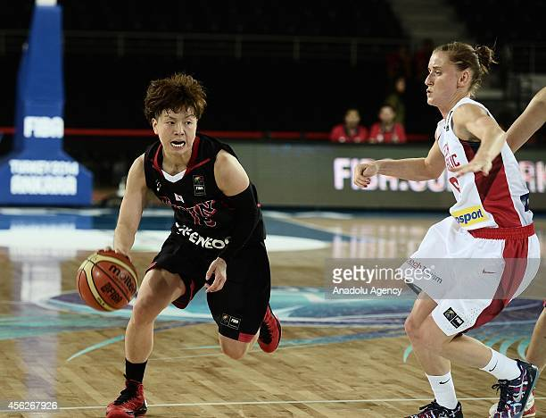 Yuko Oga of Japan drives towards the hoop during the 2014 FIBA World Championship for Women Group A game between Czech Republic and Japan at Ankara...