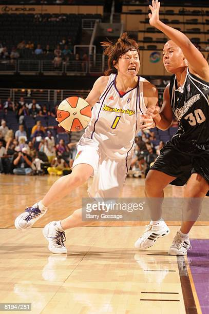 Yuko Oga of the Phoenix Mercury drives against Helen Darling of the San Antonio Silver Stars on July 15 at US Airways Center in Phoenix Arizona NOTE...