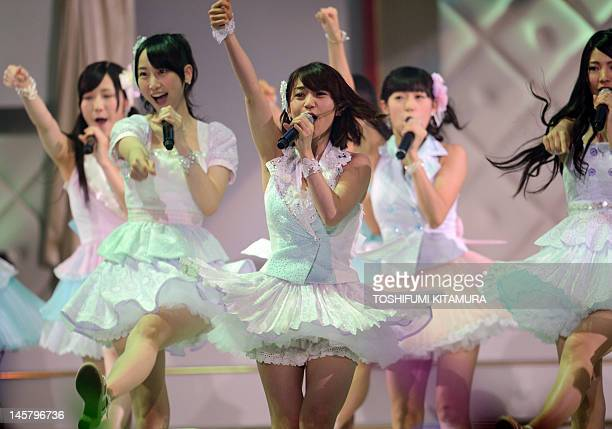 Yuko Oshima and other AKB48 members perform on a stage prior to their 27th song selection called the AKB48 General Election in Tokyo on June 6 2012...