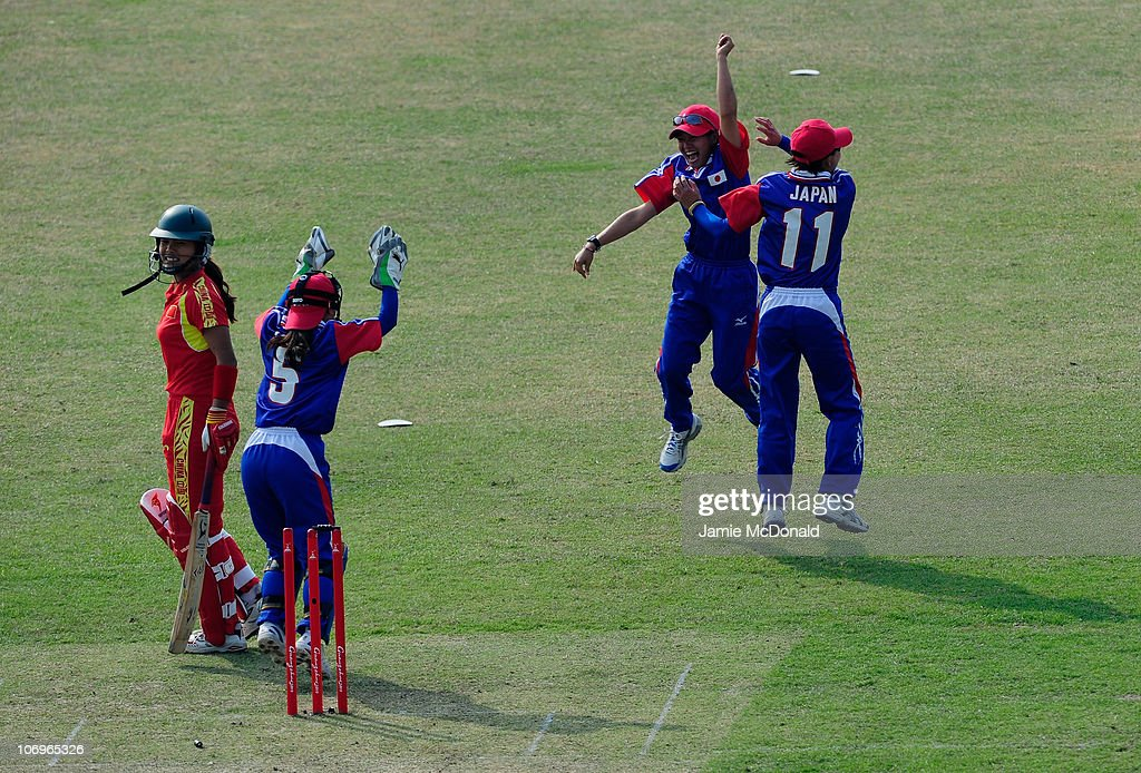Yuko Saito of Japan celebrates the wicket of Mengyao Sun of China during the Woman's Bronze Medal match between Japan and China at Guanggong Cricket Stadium during day seven of the 16th Asian Games Guangzhou 2010 on November 19, 2010 in Guangzhou, China.