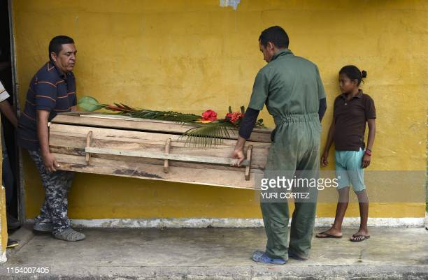 Yukpa natives carry the coffin of a relative who died due to a gastric ulcer while heading to the cemetery of Los Angeles del Tukuko community near...