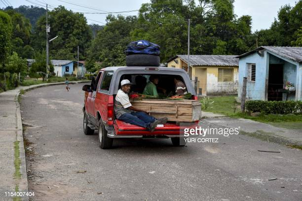 Yukpa natives travel with the coffin of a relative who died due to a gastric ulcer on their way to the cemetery at Los Angeles del Tukuko community...