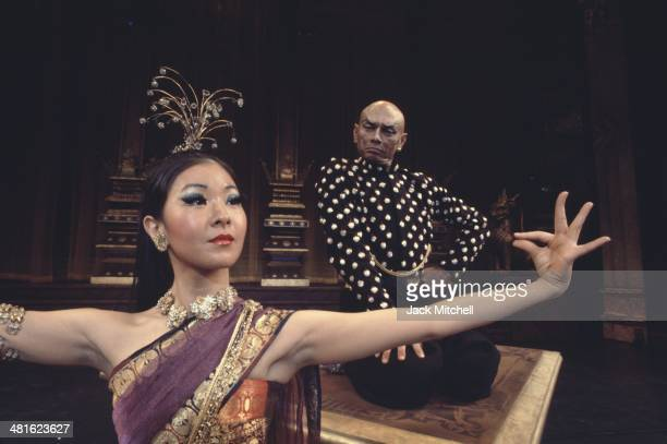 Yul Brenner and June Angela performing on stage with the Broadway cast of 'The King and I' in 1977