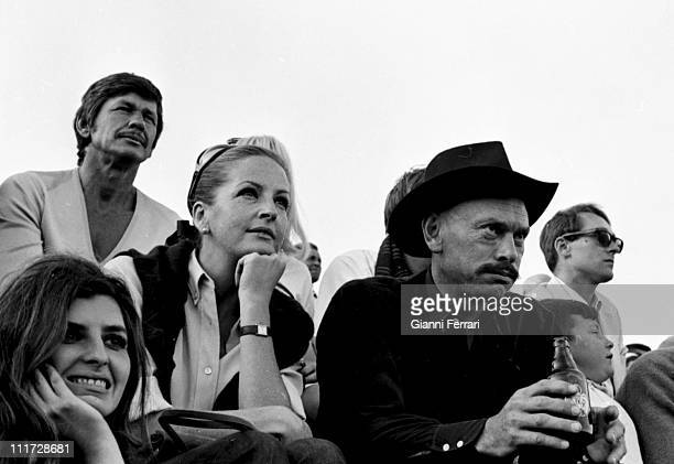 Yul Brynner and his wife Doris Kleiner on the farm 'La Paz' of the bullfighter Luis Miguel Dominguin attend a bullfight Cuenca Spain