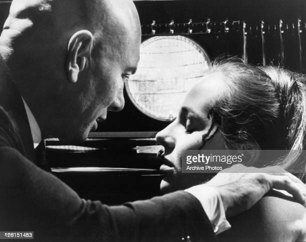 Yul Brynner comforts his dying girlfriend Hilary Heath in a scene from the film 'The File Of The Golden Goose' 1969