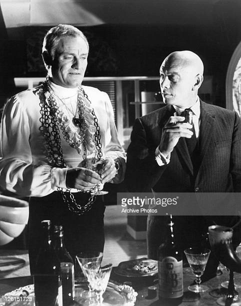 Charles gray stock photos and pictures getty images yul brynner gets rough with charles gray discuss a business proposition in a scene from the publicscrutiny Image collections