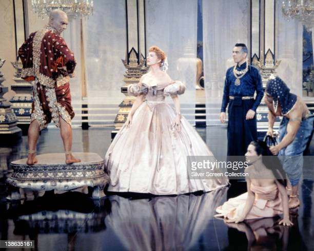 Yul Brynner , Russian-born US actor, and Deborah Kerr , both in costume, in a publicity still issued for the film, 'The King and I', 1956. The...