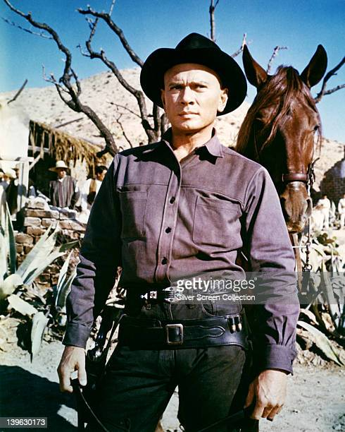 Yul Brynner Russianborn US actor in costume in a publicity still issued for the film 'Return of the Seven' 1960 The musical directed by Burt Kennedy...