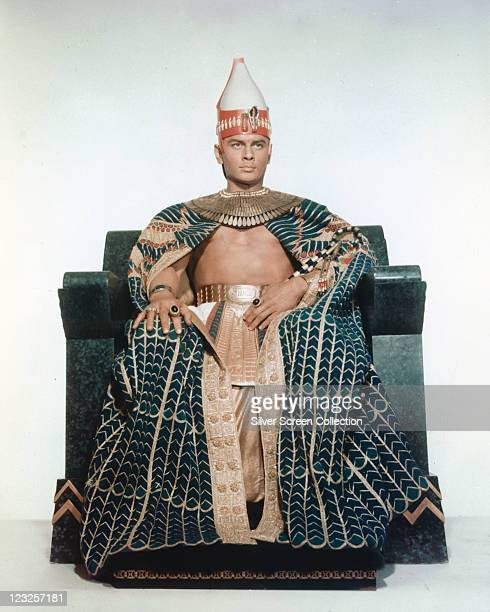 Yul Brynner Russianborn US actor in costume sitting on a throne in a publicity portrait issued for the film 'The Ten Commandments' 1956 The biblical...