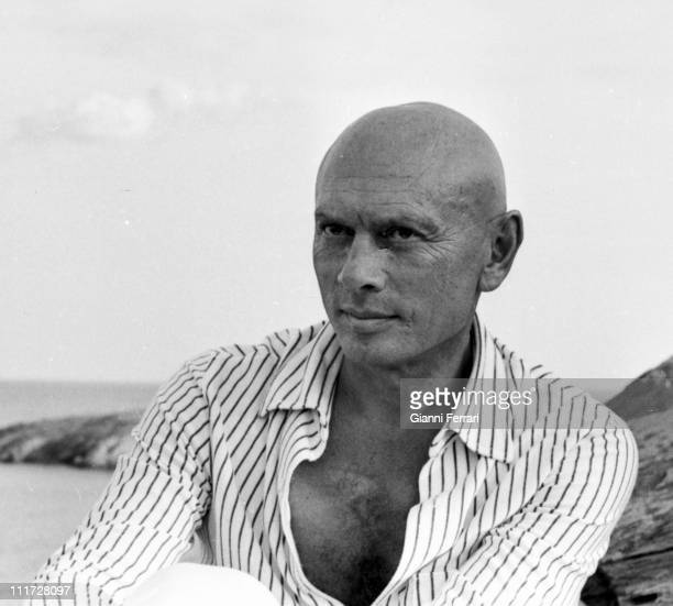 Yul Brynner with a dog on the Catalan coast during a break from filming of the movie 'The Light of the Edge of the World' Cadaques Spain
