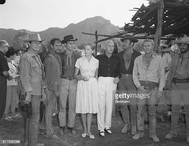 Yul Brynner with his recently married wife Doris on the set of The Magnificent Seven From left to right are Charles Bronson Eli Wallach Horst...