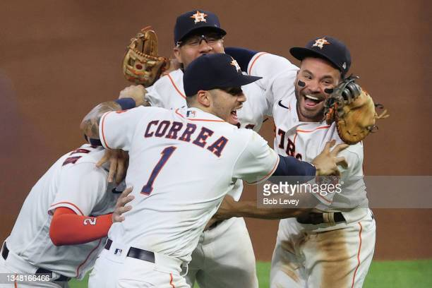 Yuli Gurriel, Alex Bregman, Jose Altuve and Carlos Correa of the Houston Astros celebrate after the final out as they defeat the Boston Red Sox 5-0...