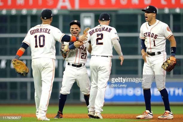 Yuli Gurriel, Jose Altuve, Alex Bregman and Carlos Correa of the Houston Astros celebrate after the final out of Game 2 of the ALDS to win 3-1 over...