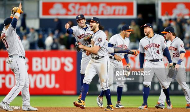 Yuli Gurriel Jose Altuve Jake Marisnick Carlos Correa George Springer and Josh Reddick of the Houston Astros celebrate after defeaating the New York...
