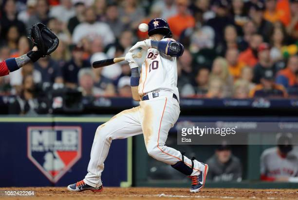 Yuli Gurriel of the Houston Astros avoids a pitch in the seventh inning against the Boston Red Sox during Game Four of the American League...