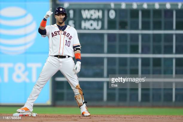 Yuli Gurriel of the Houston Astros celebrates after he hits a two RBI double against the Washington Nationals during the first inning in Game One of...