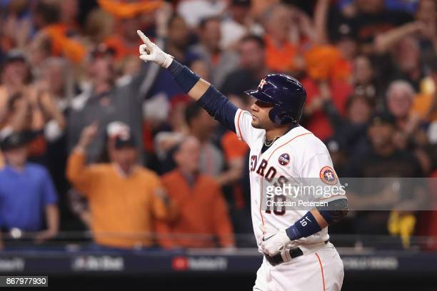 Yuli Gurriel of the Houston Astros celebrates after hitting a three run home run during the fourth inning against the Los Angeles Dodgers in game...