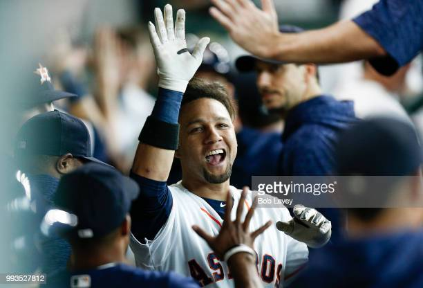 Yuli Gurriel of the Houston Astros celebrates in the dugiut after hitting a threerun home run in the third inning against the Chicago White Sox at...