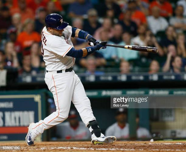 Yuli Gurriel of the Houston Astros doubles in Josh Reddick in the ninth inning against the Washington Nationals at Minute Maid Park on August 24 2017...