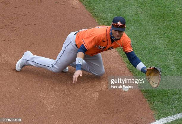 Yuli Gurriel of the Houston Astros fields the ball hit by Jorge Polanco of the Minnesota Twins during the second inning of Game One in the Wild Card...