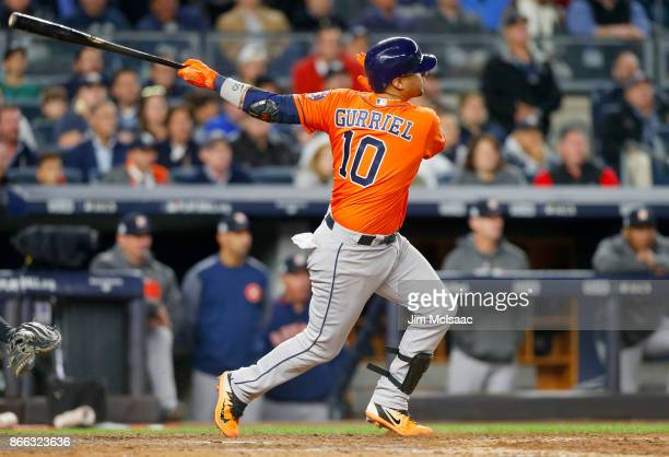 Yuli Gurriel of the Houston Astros follows through on a sixth inning three run double against the New York Yankees in Game Four of the American...