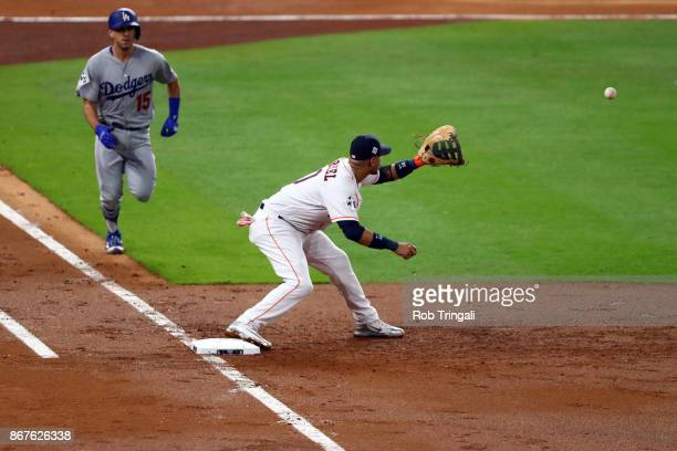 Yuli Gurriel of the Houston Astros forces out Austin Barnes of the Los Angeles Dodgers at first base during Game 4 of the 2017 World Series at Minute...