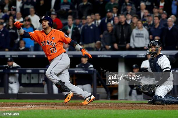 Yuli Gurriel of the Houston Astros hits a 3run double during the sixth inning against the New York Yankees in Game Four of the American League...