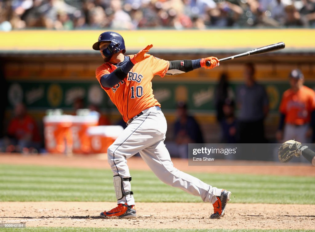 Yuli Gurriel #10 of the Houston Astros hits a double that scored two runs in the eighth inning against the Oakland Athletics at Oakland Alameda Coliseum on May 9, 2018 in Oakland, California.