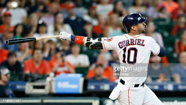 Yuli Gurriel of the Houston Astros hits a grand slam in the sixth inning against the Los Angeles Angels of Anaheim at Minute Maid Park on July 07,...