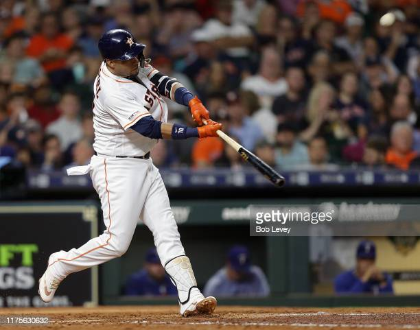 Yuli Gurriel of the Houston Astros hits a home run in the fifth inning against the Texas Rangers at Minute Maid Park on September 18 2019 in Houston...