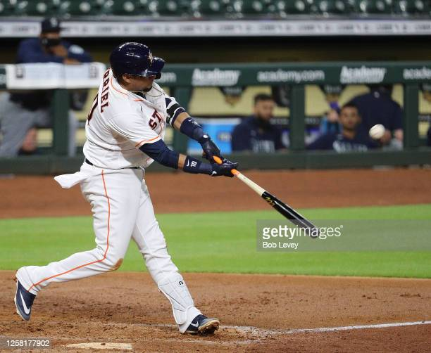 Yuli Gurriel of the Houston Astros hits a home run in the fourth inning against the Seattle Mariners at Minute Maid Park on July 25, 2020 in Houston,...