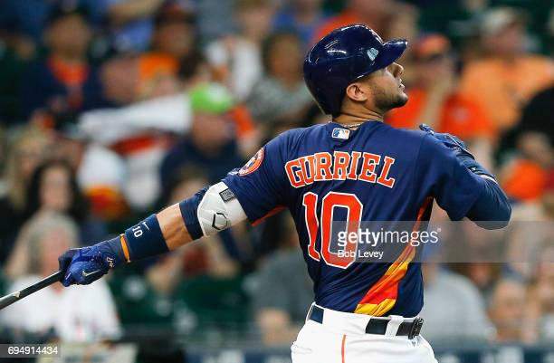 Yuli Gurriel of the Houston Astros hits a home run in the fourth inning against the Los Angeles Angels of Anaheim at Minute Maid Park on June 11 2017...