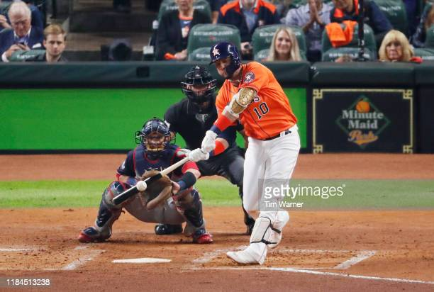 Yuli Gurriel of the Houston Astros hits a solo home run against the Washington Nationals during the second inning in Game Seven of the 2019 World...