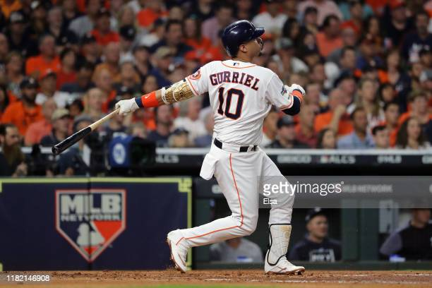 Yuli Gurriel of the Houston Astros hits a three-run home run against the New York Yankees during the first inning in game six of the American League...