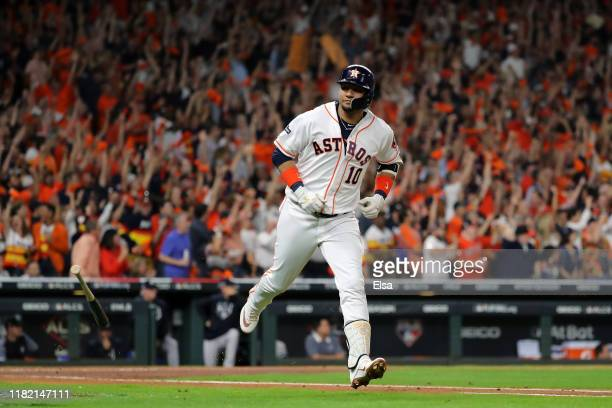 Yuli Gurriel of the Houston Astros hits a threerun home run against the New York Yankees during the first inning in game six of the American League...