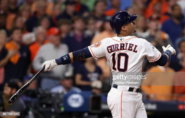 Yuli Gurriel of the Houston Astros hits a threerun home run during the fourth inning against the Los Angeles Dodgers in game five of the 2017 World...