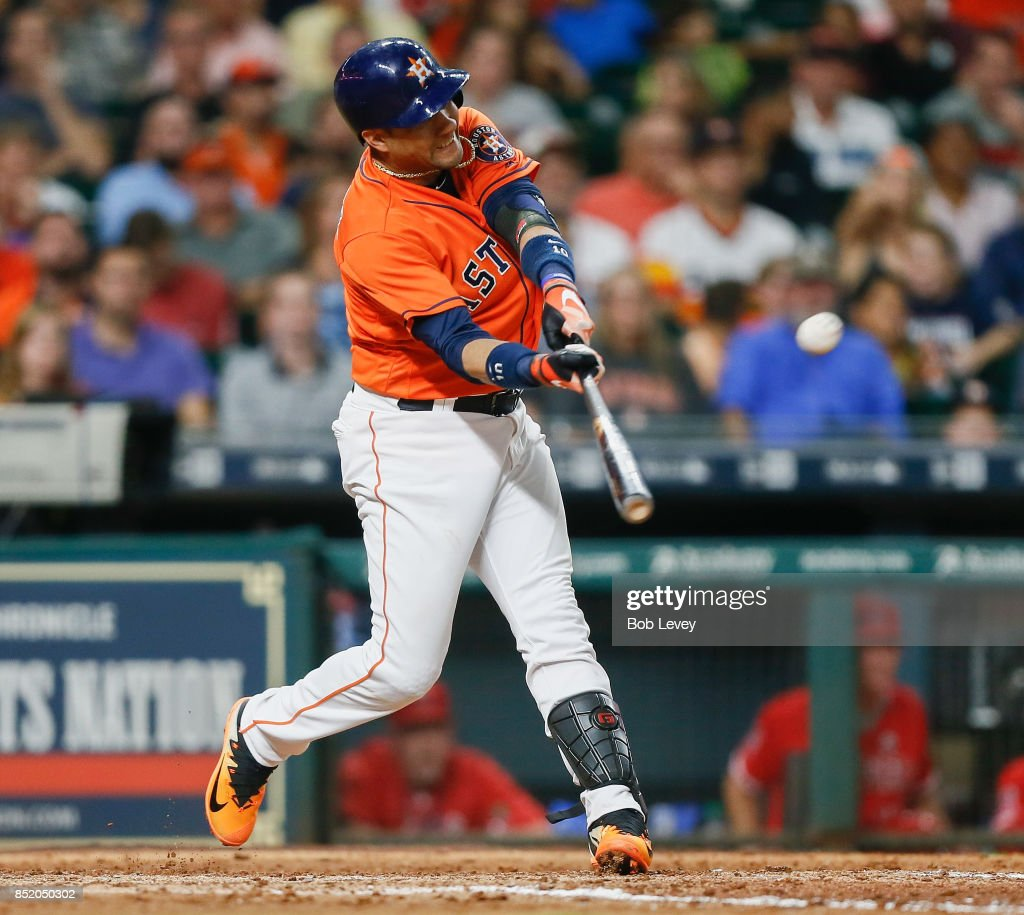 Yuli Gurriel #10 of the Houston Astros hits a three-run home run in the seventh inning against the Los Angeles Angels of Anaheim at Minute Maid Park on September 22, 2017 in Houston, Texas.