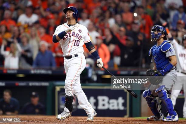 Yuli Gurriel of the Houston Astros hits a threerun home run in the fourth inning during Game 5 of the 2017 World Series against the Los Angeles...