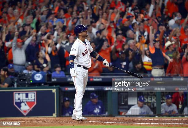 Yuli Gurriel of the Houston Astros hits a threerun home run in the fourth inning of Game 5 of the 2017 World Series against the Los Angeles Dodgers...