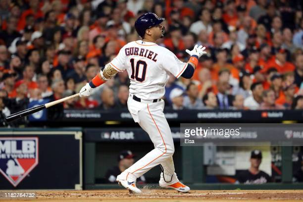 Yuli Gurriel of the Houston Astros hits a two RBI double against the Washington Nationals during the first inning in Game One of the 2019 World...