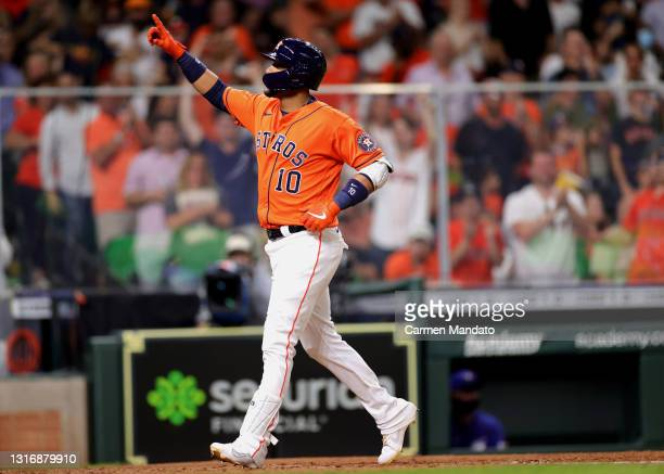 Yuli Gurriel of the Houston Astros hits a two run home run during the fifth inning against the Toronto Blue Jays at Minute Maid Park on May 07, 2021...