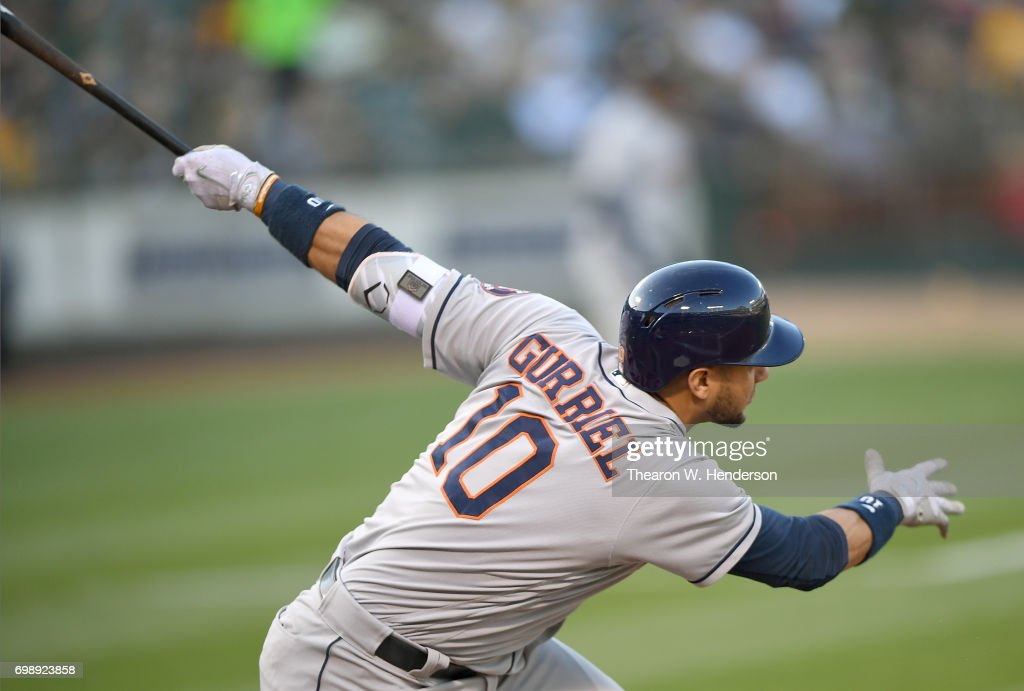 Yuli Gurriel #10 of the Houston Astros hits an rbi double scoring Brian McCann #16 against the Oakland Athletics in the top of the first inning at Oakland Alameda Coliseum on June 20, 2017 in Oakland, California.