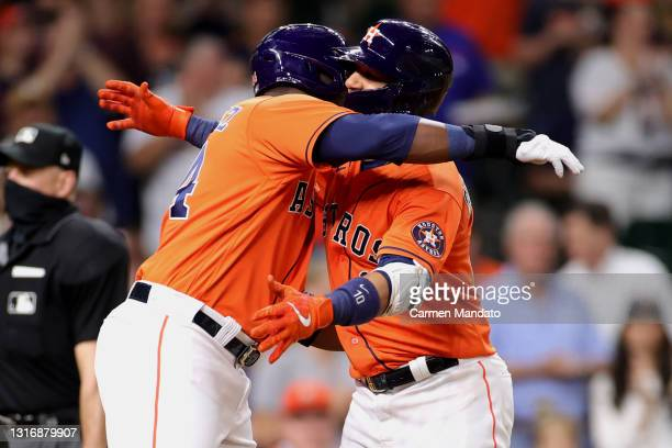 Yuli Gurriel of the Houston Astros hugs Yordan Alvarez after hitting a two run home run during the fifth inning against the Toronto Blue Jays at...