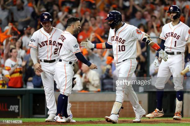Yuli Gurriel of the Houston Astros is congratulated by his teammate Jose Altuve after his threerun home run against the New York Yankees during the...