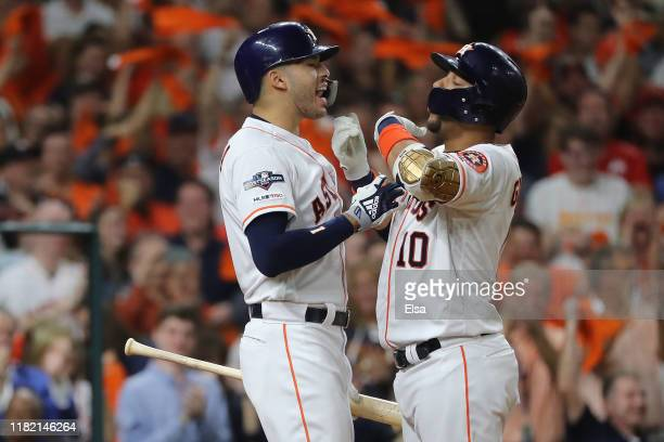 Yuli Gurriel of the Houston Astros is congratulated by his teammate Carlos Correa after his three-run home run against the New York Yankees during...