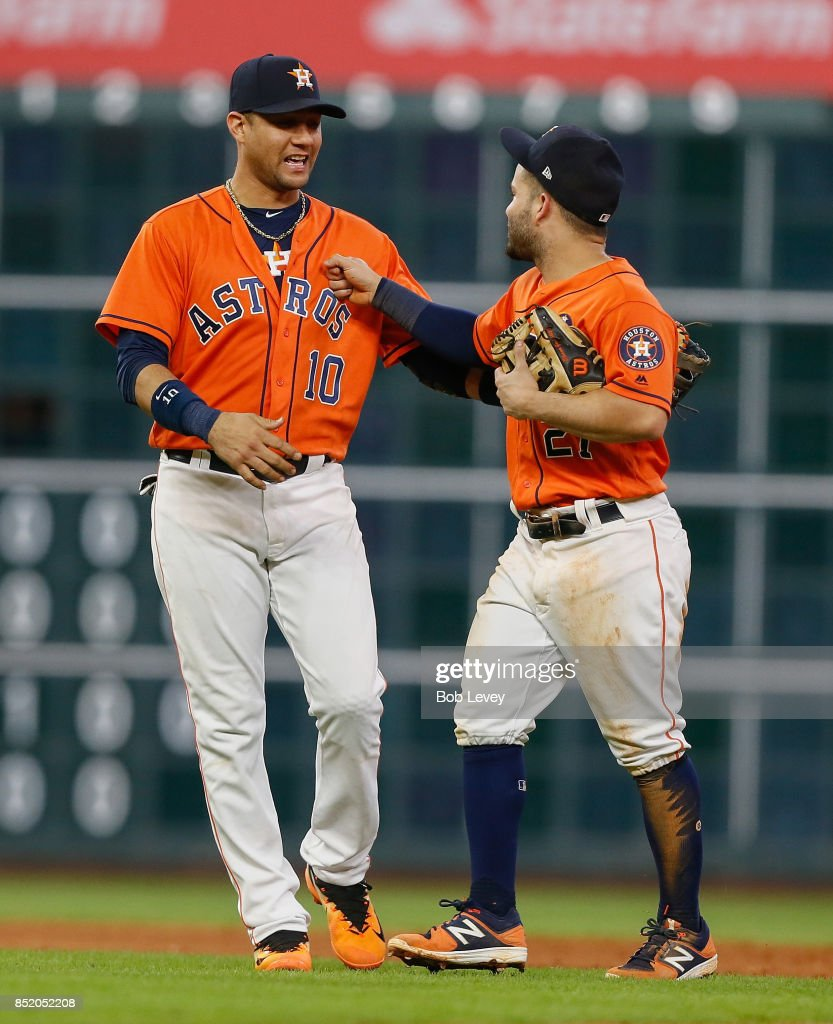 Yuli Gurriel #10 of the Houston Astros nad Jose Altuve #27 celebrate a 3-0 win over the Los Angeles Angels of Anaheim at Minute Maid Park on September 22, 2017 in Houston, Texas.
