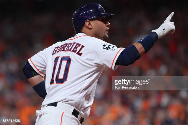 Yuli Gurriel of the Houston Astros reacts after hitting a solo home run during the second inning against the Los Angeles Dodgers in game three of the...
