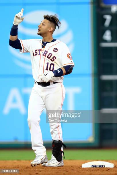 Yuli Gurriel of the Houston Astros reacts to hitting a double in the ninth inning during Game 5 of the 2017 World Series against the Los Angeles...