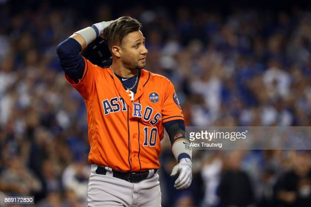 Yuli Gurriel of the Houston Astros reacts to striking out to end the top of the third inning during Game 7 of the 2017 World Series against the Los...