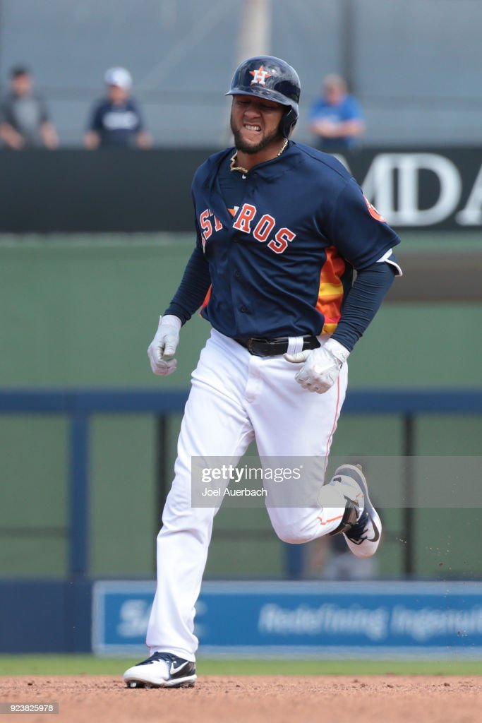 Yuli Gurriel #10 of the Houston Astros rounds the bases after hitting a solo home fun against the Atlanta Braves during a spring training game at The Ballpark of the Palm Beaches on February 24, 2018 in West Palm Beach, Florida.